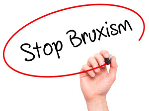 Man Hand writing Stop Bruxism with black marker on visual screen. Business, technology, internet concept