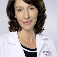 professional image of Helen Jackman, owner of Age Perfectly, wearing her lab coat